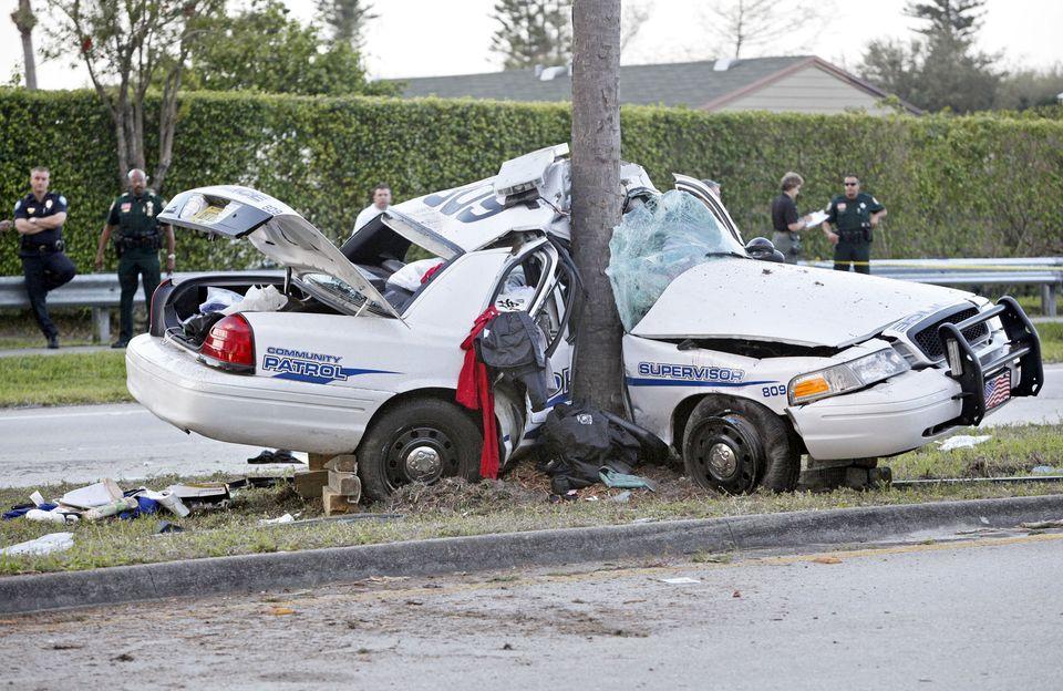 wrecked cop car - EPautos - Libertarian Car Talk