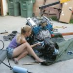 girl-working-on-engine-pic-300×225